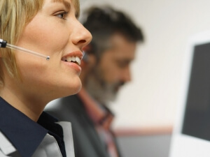 Customer Service Rep Using Telephone Headset